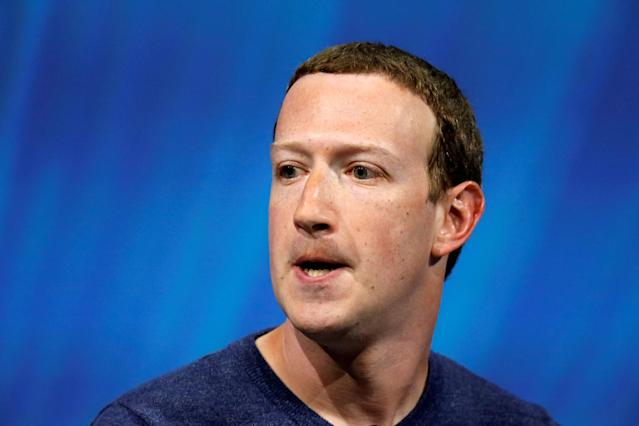 FILE PHOTO: Facebook's founder and CEO Mark Zuckerberg reacts as he speaks at the Viva Tech start-up and technology summit in Paris, France, May 24, 2018. REUTERS/Charles Platiau/File Photo