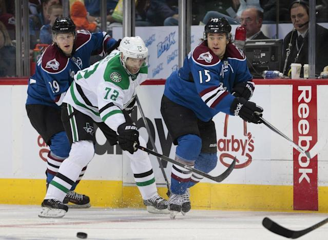 Dallas Stars right wing Erik Cole (72) defends Colorado Avalanche right wing P.A. Parenteau (15) as he and Avalanche center Nathan MacKinnon (29) react to the puck in the third period of a hockey game in Denver on Tuesday, Oct. 15, 2013. Colorado won 3-2. (AP Photo/Joe Mahoney)