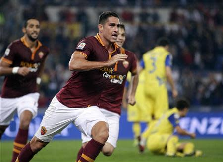 AS Roma's Marco Borriello celebrates after scoring against Chievo Verona during their Italian Serie A soccer match at the Olympic stadium in Rome October 31, 2013. REUTERS/Max Rossi