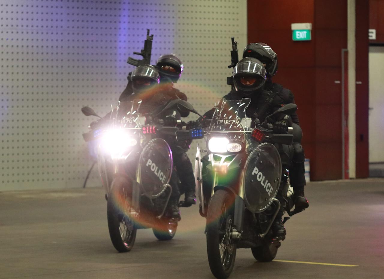 <p>The SOC's Rapid Deployment Troops re-enacted a simulated threat using their tactical response motorcycles. Photo: Hannah Teoh/Yahoo News Singapore </p>