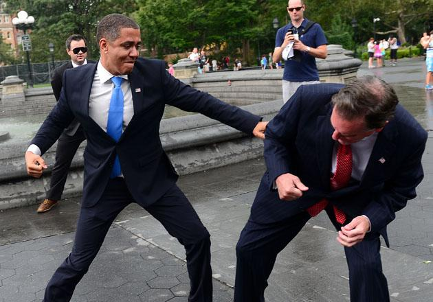 "US Presidential candidate Mitt Romney impersonator Mike Cote (R) ""fights"" with US President Barack Obama impersonator Reggie Brown during an Obama vs Romney ""showdown"" in Washington Square Park in New York on September 05, 2012.   AFP PHOTO/Emmanuel Dunand"