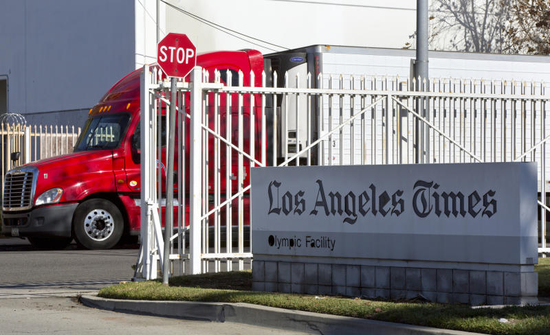 A truck is parked outside the Los Angeles Times Olympic Facility in Los Angeles, Sunday, Dec. 30, 2018. A computer virus hit the newspaper printing plant in Los Angeles, and at Tribune Publishing newspapers across the country. (AP Photo/Damian Dovarganes)