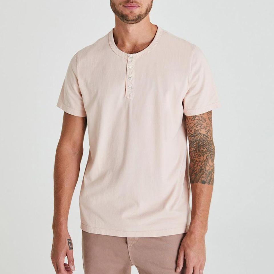 """<p>agjeans.com<br>$128.00</p><p><a class=""""link rapid-noclick-resp"""" href=""""https://www.agjeans.com/the-clyde-s%2Fs-henley-70883LFYLSHT.html"""" rel=""""nofollow noopener"""" target=""""_blank"""" data-ylk=""""slk:BUY IT HERE"""">BUY IT HERE</a></p><p>AG's soft cotton jersey in their unique pale pastel color is well done for guys that are looking for something out of the dark toned world of dressing. The subtle shade of color, paired with the durable knit fabric, are the perfect complement for your new summer tan. </p>"""