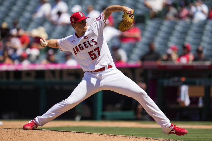 Los Angeles Angels relief pitcher Aaron Slegers (57) throws during the sixth inning of a baseball game against the Baltimore Orioles Sunday, July 4, 2021, in Anaheim, Calif. (AP Photo/Ashley Landis)