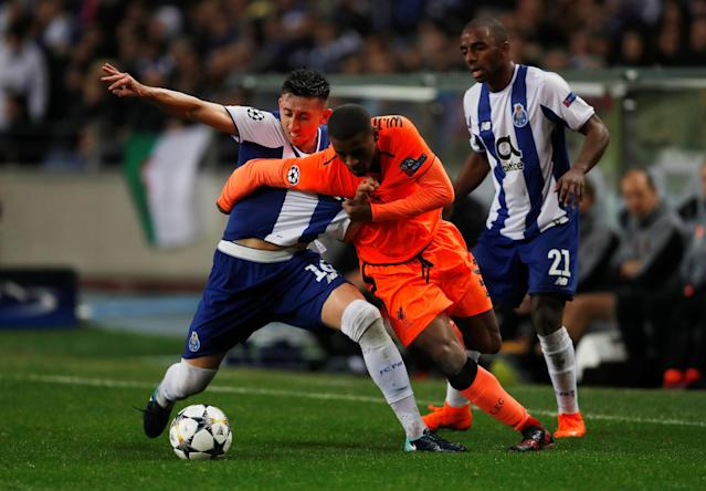 Soccer Football - Champions League Round of 16 First Leg - FC Porto vs Liverpool - Estadio do Dragao, Porto, Portugal - February 14, 2018 Liverpool's Georginio Wijnaldum in action with Porto's Hector Herrera Action Images via Reuters/Matthew Childs