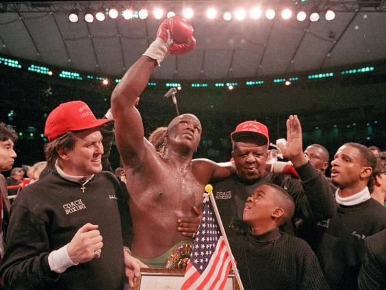 Buster Douglas celebrates his victory at the Tokyo Dome (AP)