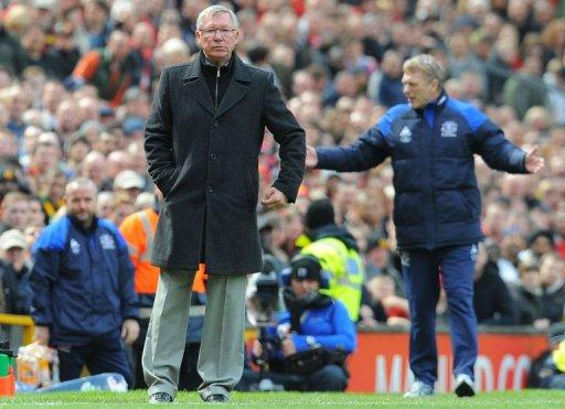 Manchester United manager Sir Alex Ferguson attends the English Premier League football match between Manchester United and Everton at Old Trafford in Manchester. Ferguson has said the upcoming clash with Premier League title rivals Manchester City represents the most important derby match of his career