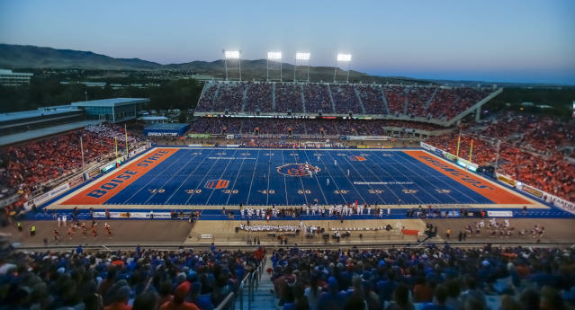 Boise State's Albertsons Stadium is known for its famous blue turf. (AP Photo/Otto Kitsinger)