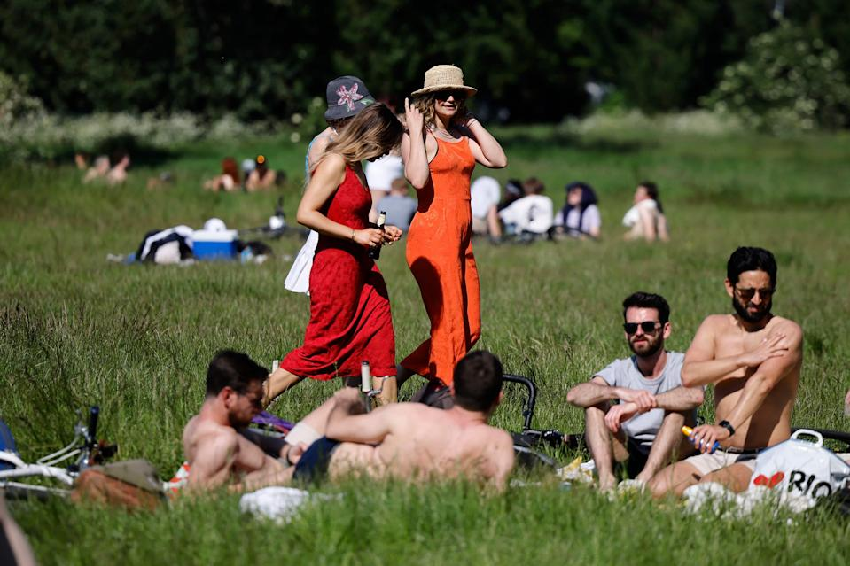 <p>Sun-seekers at Hackney Marshes in east London on Monday</p> (AFP via Getty Images)