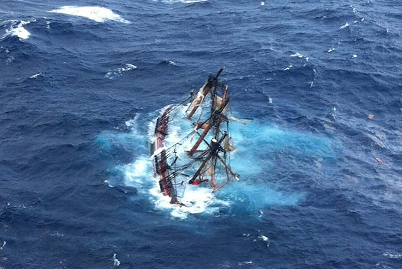 AT SEA - OCTOBER 29:  In this handout image supplied by the US Coast Guard, The HMS Bounty, a 180-foot sailboat, is submerged in the Atlantic Ocean during Hurricane Sandy approximately 90 miles southeast of Hatteras, North Carolina, on October 29, 2012. Of the 16-person crew, the Coast Guard rescued 14, recovered a woman who was later pronounced dead and are searching for the captain. The HMS Bounty was built for the 1962 film Mutiny On The Bounty and was also used in Pirates Of The Caribbean. Hurricane Sandy, which threatens 50 million people in the eastern third of the U.S., is expected to bring days of rain, high winds and possibly heavy snow.  (Photo by Petty Officer 2nd Class Tim Kuklewski/ /U.S. Coast Guard via Getty Images)