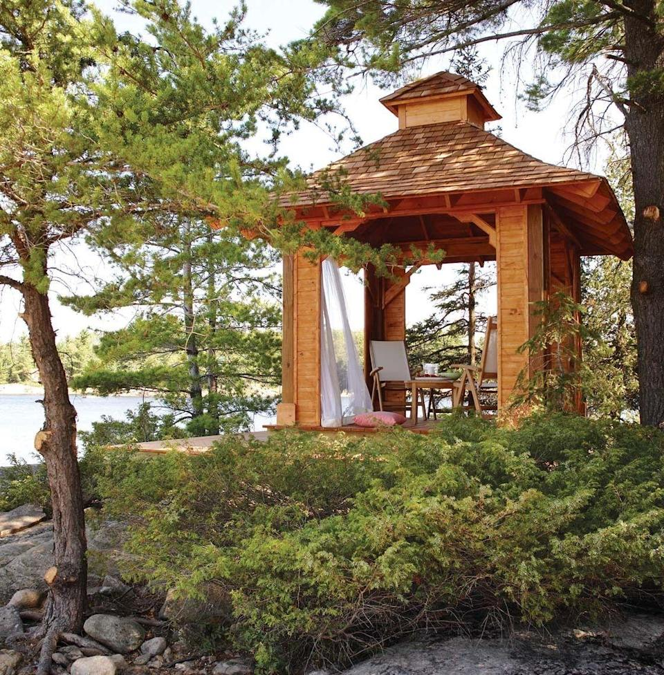 """<p>This golden-hued gazebo combines Canadian cottage materials, like cedar shakes with traditional Balinese hallmarks, including a raised floor and wide, flared eaves. This free plan even includes a built-in storage space for a cooler. </p><p><strong>Get the tutorial at <a href=""""http://www.theclassicarchives.com/how-to-guides/free-garden-gazebo-plans"""" rel=""""nofollow noopener"""" target=""""_blank"""" data-ylk=""""slk:The Classic Archives"""" class=""""link rapid-noclick-resp"""">The Classic Archives</a>. </strong></p>"""