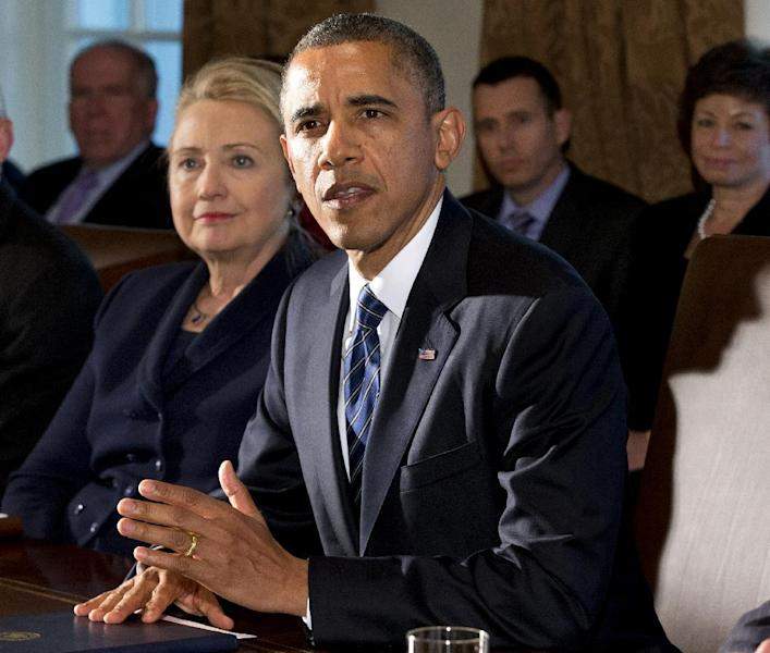 FILE - This Nov. 28, 2012 file photo shows then-Secretary of State Hillary Rodham Clinton listening as President Barack Obama speaks in the Cabinet Room at the White House in Washington. On its face, the annual Clinton Global Initiative meeting here provided a platform for Bill, Hillary and Chelsea Clinton to announce a series of financial commitments from corporations, non-governmental organizations and philanthropists to address intractable problems around the globe. Perhaps more than any other year, however, the New York gathering of Clinton loyalists and luminaries offered a vivid look at the past, present and future of one of America's most dominant political families. (AP Photo/Jacquelyn Martin, File)
