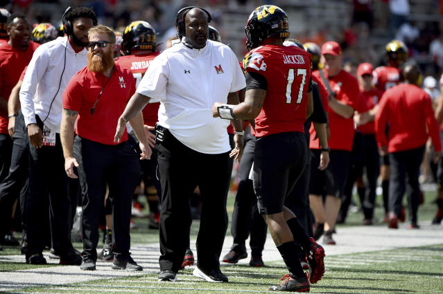 Maryland head coach Michael Locksley celebrates with quarterback Josh Jackson (17) after scoring a touchdown against Syracuse during the second half of an NCAA college football game, Saturday, Sept. 7, 2019, in College Park, Md. (AP Photo/Will Newton)