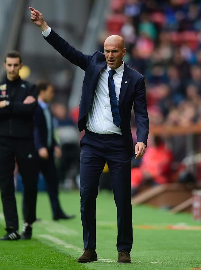 Real Madrid's Zinedine Zidane gestures during their match against Real Sporting de Gijon at El Molinon stadium in Gijon on April 15, 2017 (AFP Photo/MIGUEL RIOPA)