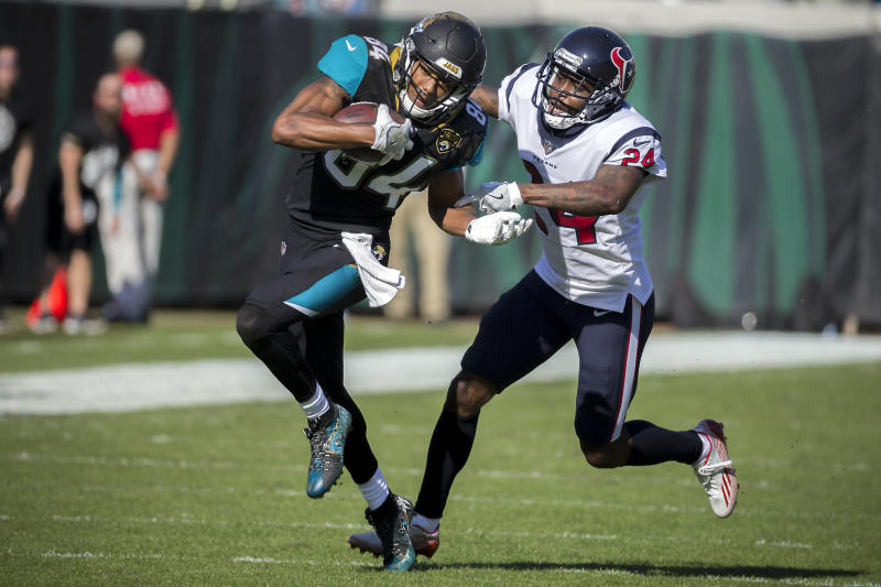 FILE - In this Sunday, Dec. 17, 2017, file photo, Jacksonville Jaguars wide receiver Keelan Cole (84) is tackled by Houston Texans cornerback Johnathan Joseph (24) during the first half of an NFL football game in Jacksonville, Fla. Defensive backs AJ Bouye and Johnathan Joseph will to use the Jaguars-Texans game in London on Nov. 3, 2019 to raise awareness of the fight against cancer. Bouye and Joseph, who have both lost parents to cancer, will donate their tickets to a lucky fan in an effort to raise more awareness for the NFLs Crucial Catchs mission.(AP Photo/Stephen B. Morton, File)