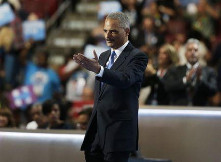 Eric Holder takes the stage during the Democratic National Convention in Philadelphia