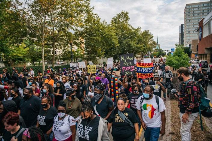 Protestors march in the street during a demonstration on September 23, 2020 in Louisville, Kentucky. (Photo by Brandon Bell/Getty Images)