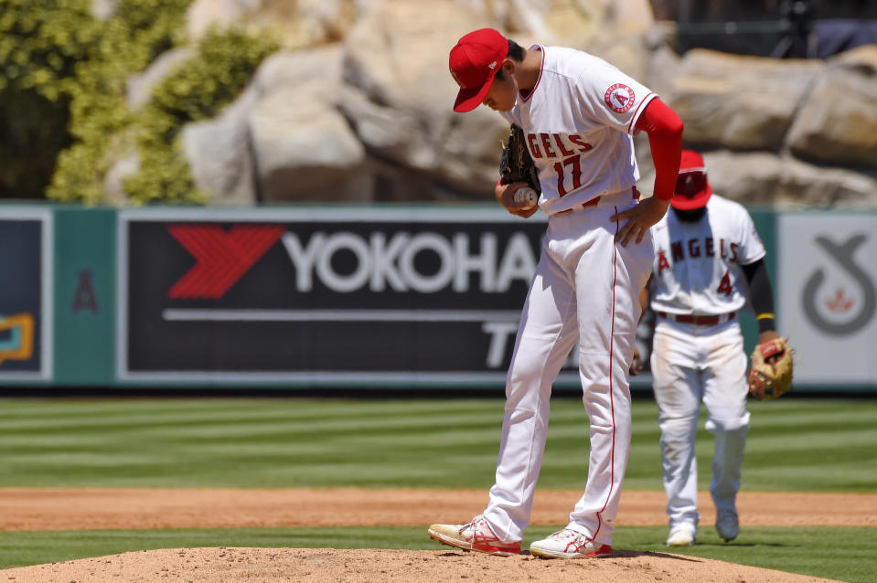 Los Angeles Angels designated hitter Shohei Ohtani, of Japan, stands on the mound before being taken out of the game after walking in his second run during the second inning of a baseball game against the Houston Astros Sunday, Aug. 2, 2020, in Anaheim, Calif. (AP Photo/Mark J. Terrill)
