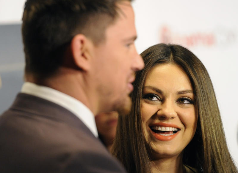 "Mila Kunis, right, a cast member in the upcoming film ""Jupiter Ascending,"" looks over at fellow cast member Channing Tatum as they are interviewed before the Warner Bros. presentation at CinemaCon 2014 on Thursday, March 27, 2014, in Las Vegas. (Photo by Chris Pizzello/Invision/AP)"