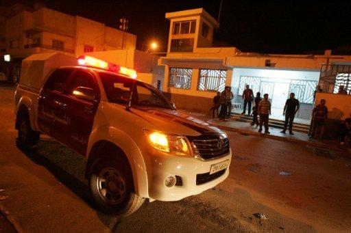 Libyan police officers stand on high alert after a car exploded