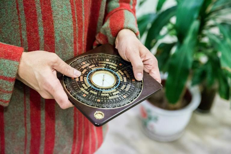 A luopan, or Chinese compass, is used by Chinese feng shui masters to find the right alignment to promote health and wealth