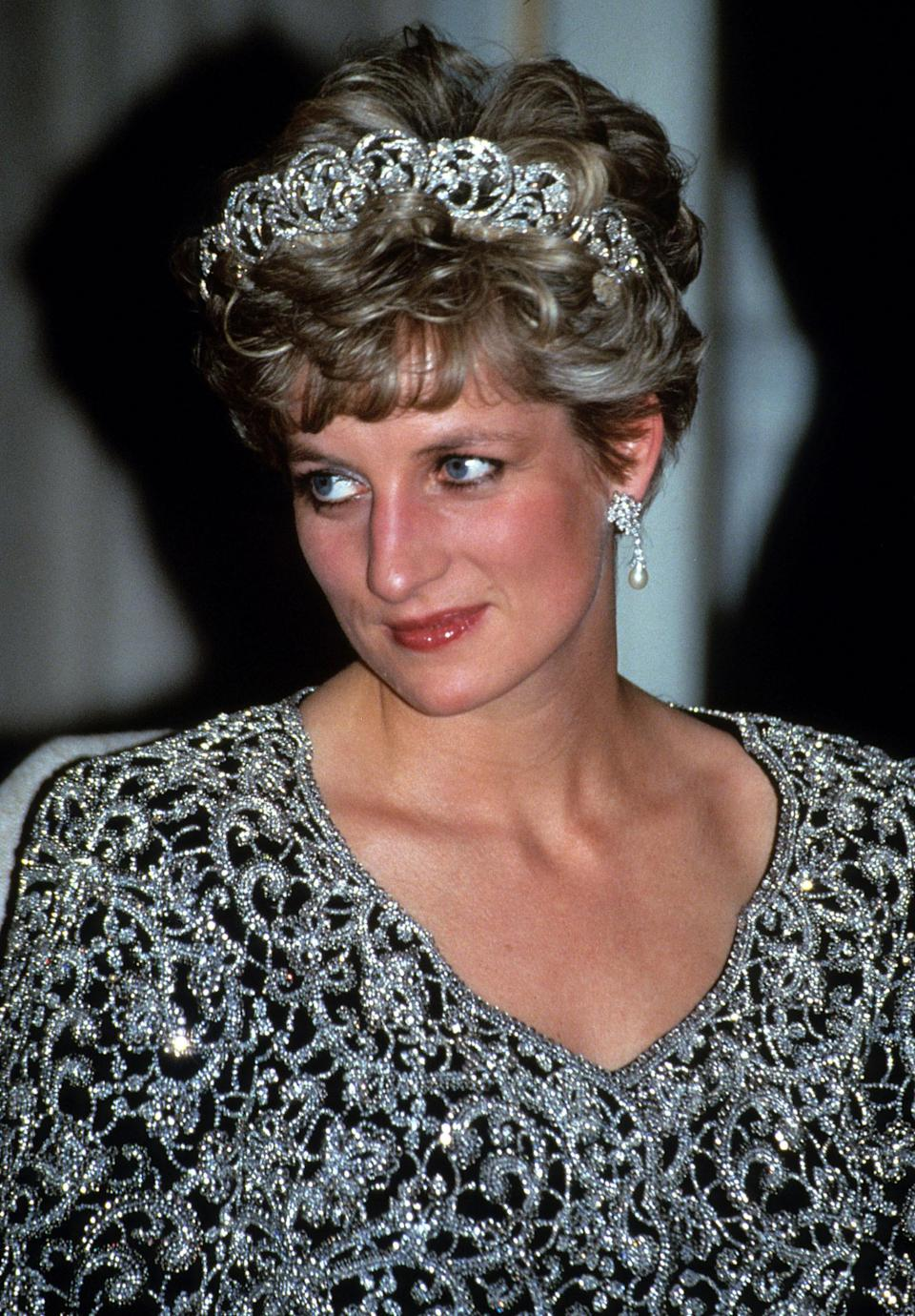 <p>During a visit to India, Princess Diana opted for a bejewelled Catherine Walker dress. She finished the look with a headful of dainty curls and of course, the family tiara.<br><em>[Photo: PA]</em> </p>