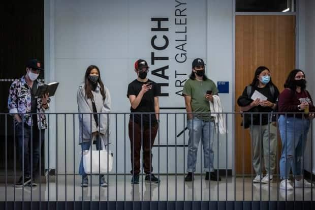 Students wait in line to cast their ballot at a polling station at the University of British Columbia in Vancouver.  (Ben Nelms/CBC - image credit)