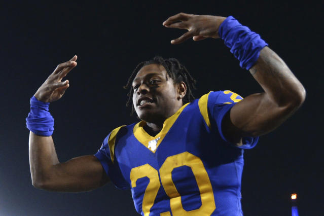 FILE - In this Nov. 17, 2019, file photo, Los Angeles Rams cornerback Jalen Ramsey celebrates the team's win over the Chicago Bears in an NFL football game in Los Angeles. Ramsey says he wont hold out as he heads into the final year of his rookie contract and his first full season with the Rams. After a tumultuous tenure in Jacksonville, the star cornerback sounds content in Los Angeles and eager to play new roles on defense. (AP Photo/Kyusung Gong, File)