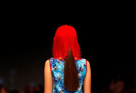 A model dressed in Romani Design clothes walks the catwalk at a fashion show in Budapest, Hungary, November 12, 2016. REUTERS/Laszlo Balogh