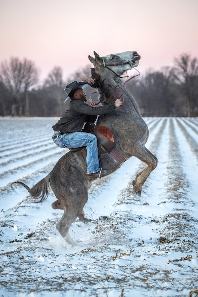 <p>A young cowboy named Gee rises on his horse after a rare snowfall in Cleveland, Miss., January 2018. (Photograph by Rory Doyle) </p>