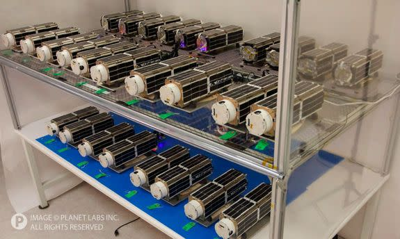 """The 28 tiny satellites that will make up Planet Labs' """"Flock 1"""" constellation of Earth-imaging spacecraft."""
