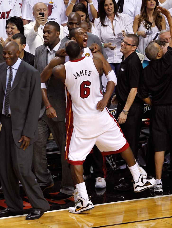 MIAMI, FL - JUNE 21:  Chris Bosh #1 and LeBron James #6 of the Miami Heat celebrate their 121-106 win against the Oklahoma City Thunder in Game Five of the 2012 NBA Finals on June 21, 2012 at American Airlines Arena in Miami, Florida. NOTE TO USER: User expressly acknowledges and agrees that, by downloading and or using this photograph, User is consenting to the terms and conditions of the Getty Images License Agreement.  (Photo by Mike Ehrmann/Getty Images)