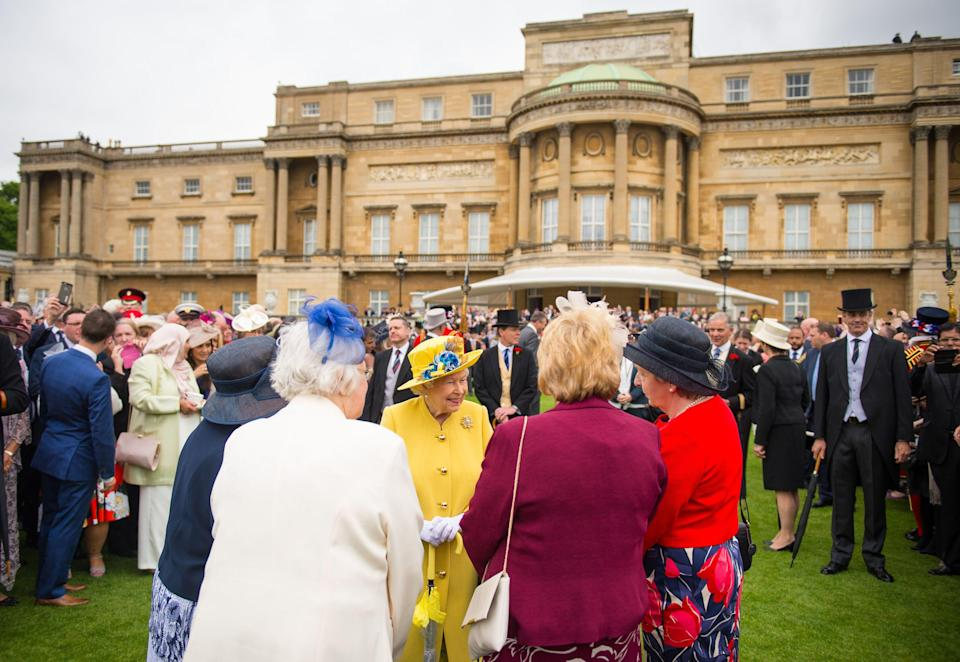 <p>The Queen greeting guests at a party at Buckingham Palace.</p> (Pa)