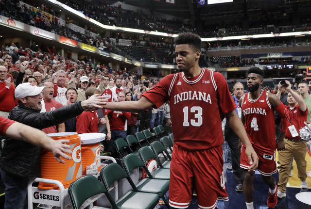 Indiana's Juwan Morgan (13) celebrates with fans after Indiana defeated Notre Dame, 80-77, in an NCAA college basketball game, Saturday, Dec. 16, 2017, in Indianapolis. (AP Photo/Darron Cummings)