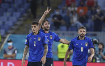 Italy's Manuel Locatelli, center, celebrates with his teammates after scoring his side's second goal during the Euro 2020 soccer championship group A match between Italy and Switzerland at Olympic stadium in Rome, Wednesday, June 16, 2021. (Ettore Ferrari, Pool via AP)