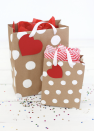 """<p>What if you don't have wrapping paper <em>or </em>gift bags handy? Before you head to the store, check to see if you have any cardboard boxes. If the answer is yes, you can make these adorable—and very professional-looking—gift bags in a flash. </p><p>Get the tutorial at <a href=""""https://abeautifulmess.com/how-to-make-professional-looking-gift-bags/"""" rel=""""nofollow noopener"""" target=""""_blank"""" data-ylk=""""slk:A Beautiful Mess"""" class=""""link rapid-noclick-resp"""">A Beautiful Mess</a>.</p>"""