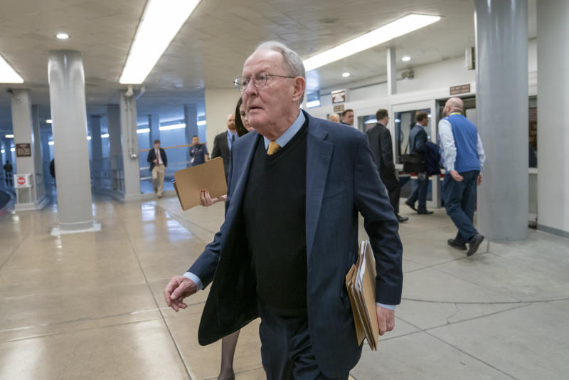 "FILE - In this Feb. 12, 2019, file photo, Sen. Lamar Alexander, R-Tenn., walks to the Senate at the Capitol in Washington. A new study says about once in every six times someone is taken to an emergency room or checks in to a hospital as an in-patient, the treatment is followed by a ""surprise"" medical bill. (AP Photo/J. Scott Applewhite, File)"