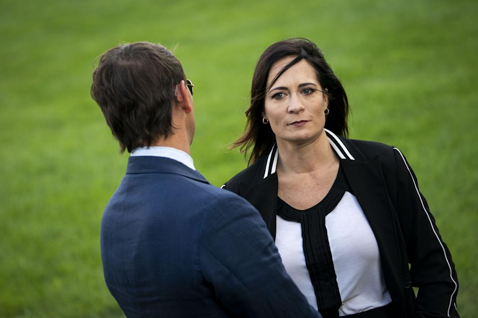 Stephanie Grisham listens to Hogan Gidley, then her White House deputy press secretary, as President Trump speaks to members of the media, Sept. 12, 2019. (Al Drago/Bloomberg via Getty Images)