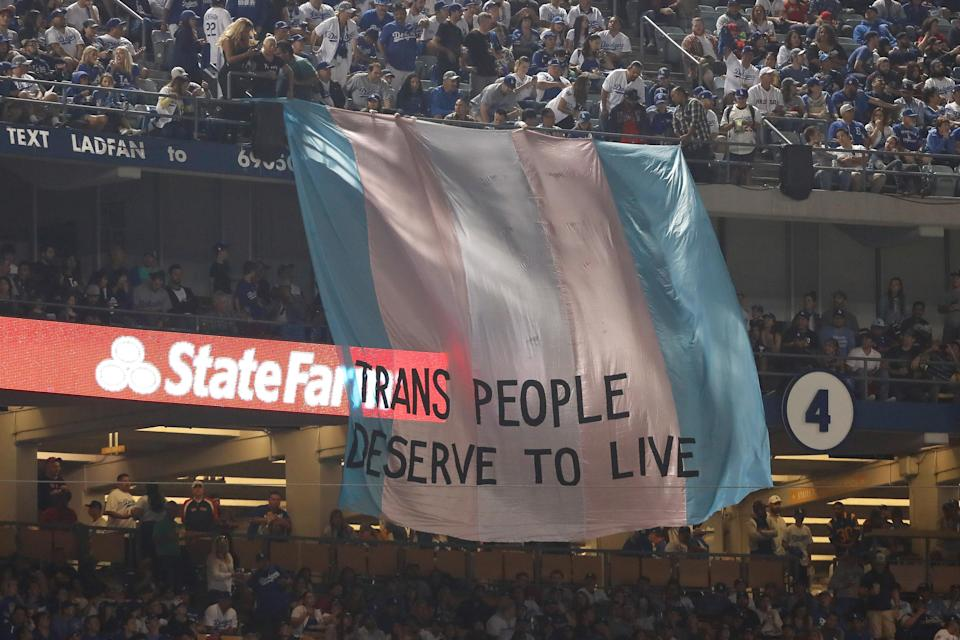 """A banner reading """"Trans people deserve to live"""" was hung at Dodger Stadium during Game 5 of the World Series. (Getty Images)"""
