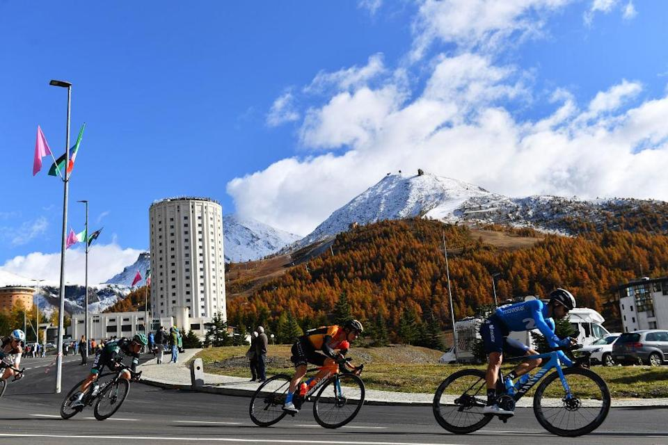 SESTRIERE ITALY  OCTOBER 24 Pello Bilbao of Spain and Team Bahrain  Mclaren  Hector Carretero of Spain and Movistar Team  Peloton  Sestriere 2035m Landscape  Mountains  Snow  during the 103rd Giro dItalia 2020 Stage 20 a 190km stage from Alba to Sestriere 2035m  girodiitalia  Giro  on October 24 2020 in Sestriere Italy Photo by Stuart FranklinGetty Images