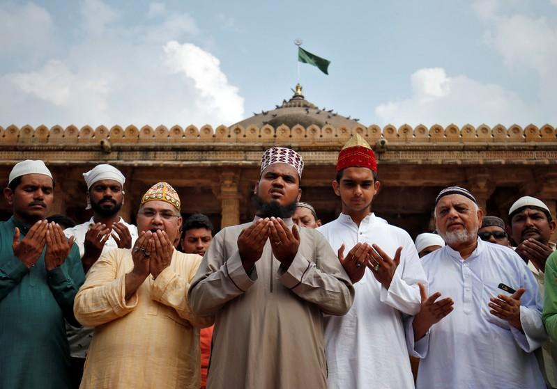 Muslims pray for peace ahead of verdict on a disputed religious site in Ayodhya, inside a mosque premises in Ahmedabad