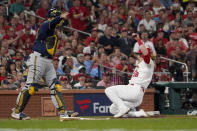 St. Louis Cardinals' Harrison Bader, right, scores past Milwaukee Brewers catcher Omar Narvaez during the fourth inning of a baseball game Tuesday, Sept. 28, 2021, in St. Louis. (AP Photo/Jeff Roberson)