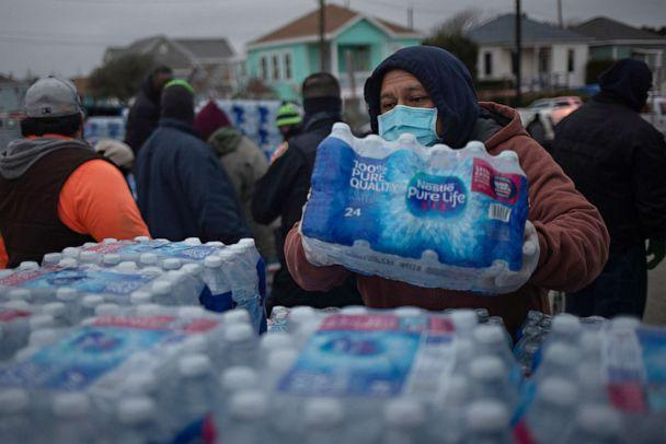 PHOTO: Volunteers help distribute water to local residents at a warming center and shelter after record-breaking winter temperatures, as local media reports most residents are without electricity, in Galveston, Texas on Feb. 17, 2021. REUTERS/Adrees Latif (Adrees Latif/Reuters)