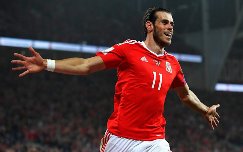 Gareth Bale of Wales celebrates scoring his sides third goal during the 2018 FIFA World Cup Qualifier Group D match between Wales and Moldova at Cardiff City Stadium on September 5, 2016 in Cardiff, Wale - Stu Forster