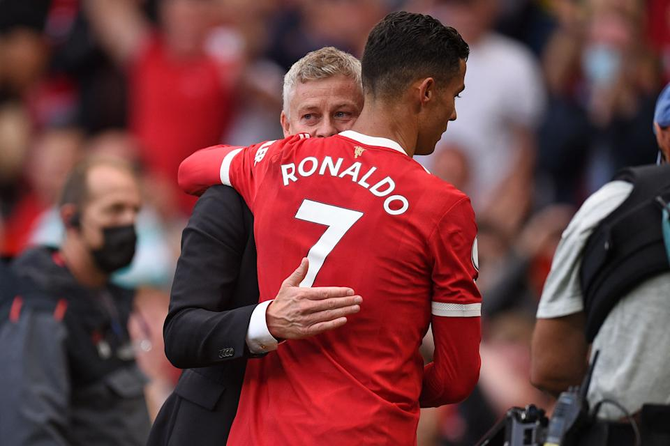 Manchester United manager Ole Gunnar Solskjaer embraces Cristiano Ronaldo after Saturday's 4-1 victory over Newcastle. (Photo by OLI SCARFF/AFP via Getty Images)