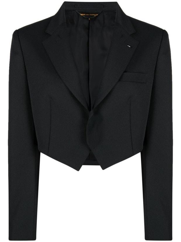 """<p>Comme Des Garçons Single-Breasted Cropped Blazer, $600 (from $1,200), <a href=""""https://rstyle.me/+XBOJ6JlehwvpWUjaYGUF9A"""" rel=""""nofollow noopener"""" target=""""_blank"""" data-ylk=""""slk:available here"""" class=""""link rapid-noclick-resp"""">available here</a> (sizes S-L). </p>"""