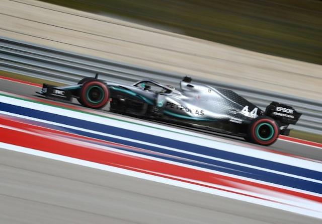 Lewis Hamilton on his way to fifth place on the grid (AFP Photo/Mark RALSTON)