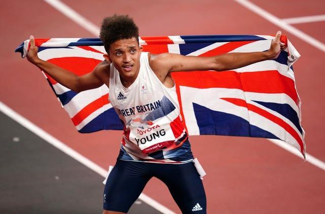 Thomas Young celebrates winning gold during the men's 100m – T38