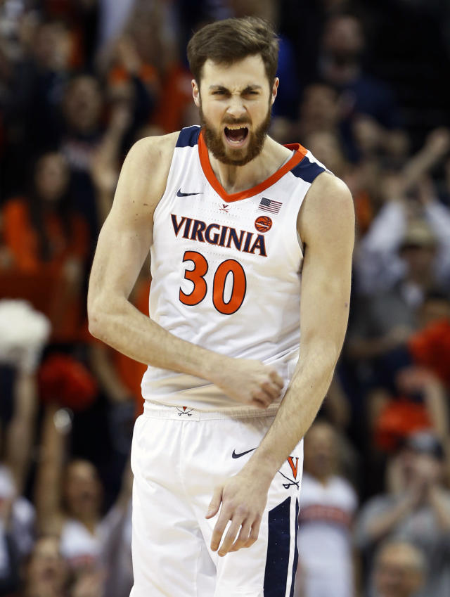 Virginia forward Jay Huff (30) reacts to a basket and a foul during the first half of an NCAA college basketball game in Charlottesville, Va., Saturday, March 9, 2019. (AP Photo/Steve Helber)