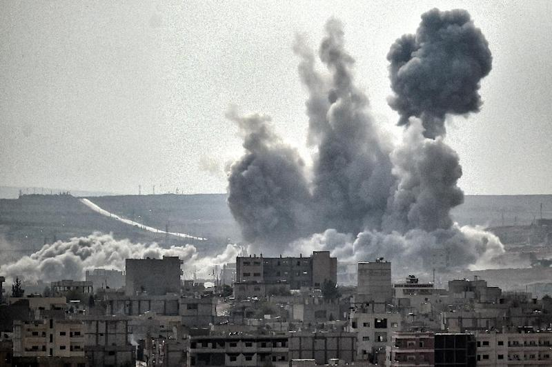 Smoke rises on November 13, 2014 after shelling in the Syrian city of Kobane, also known as Ain al-Arab, as seen from the Turkish border village of Mursitpinar, Sanliurfa province